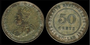 http://blog.slcollectors.com/wp-content/uploads/2010/07/King-George-V-50-cent-with-dot.jpg